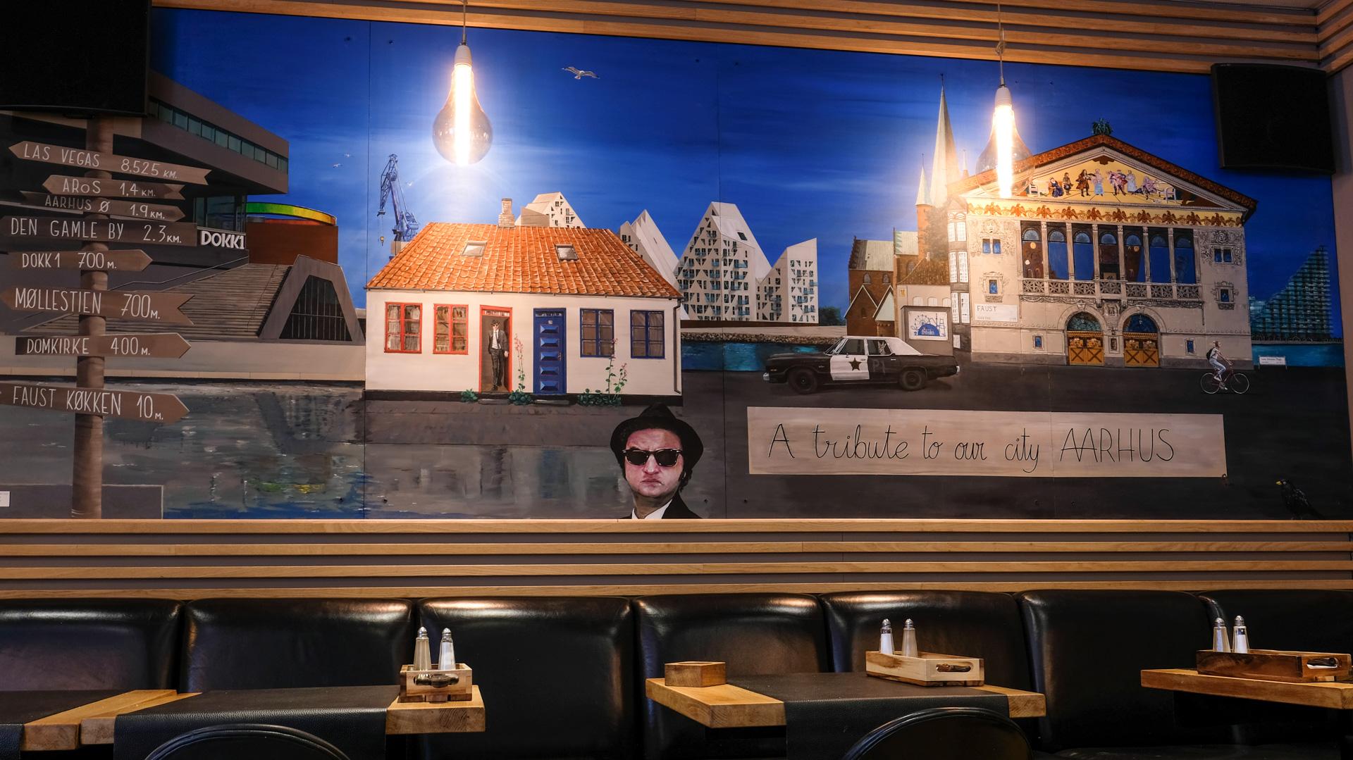 Café Faust har fået en vild idé: Maler Aarhus' historie på væggene